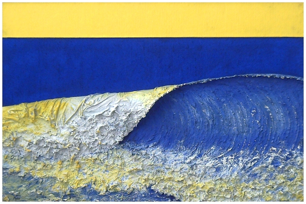 Landscape at the seashore where a wave breaks with enough foam with white and blue colors and yellow suede sky